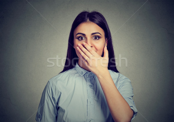 Woman looking surprised in full disbelief hand over wide open mouth Stock photo © ichiosea