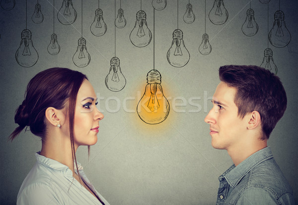 Cognitive skills ability concept, male vs female. Man and woman looking at bright light bulb  Stock photo © ichiosea