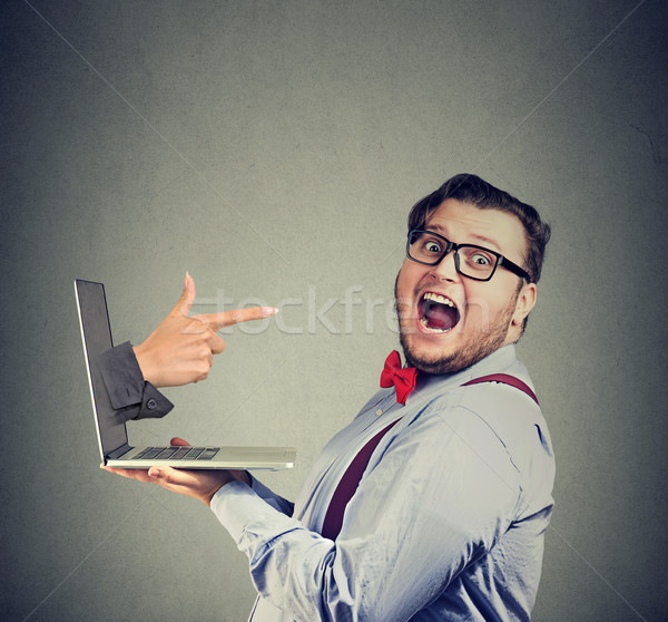 Chunky man with laptop having interview Stock photo © ichiosea