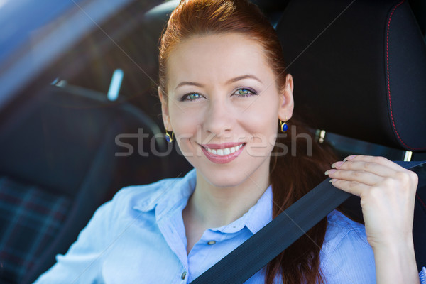Buckle up. Woman inside black car follows  traffic rules Stock photo © ichiosea