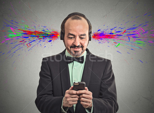 man listening music with headphones sound colorful splashes  Stock photo © ichiosea