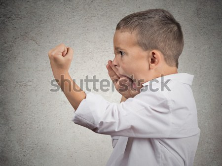 angry boy gesturing with finger against temple are you crazy? Stock photo © ichiosea