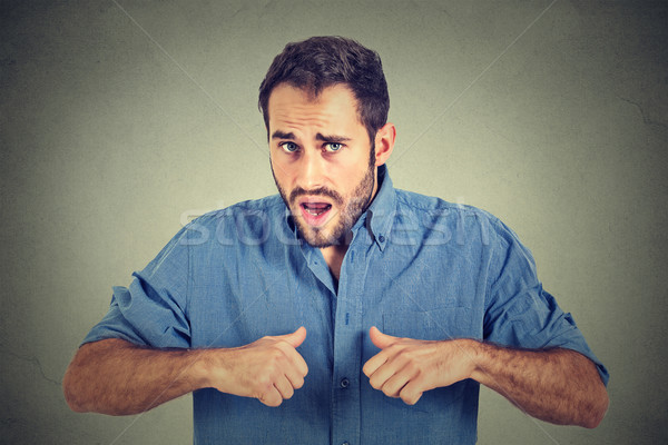 angry, mad, unhappy guy pointing at himself as if to say, you mean me? Stock photo © ichiosea