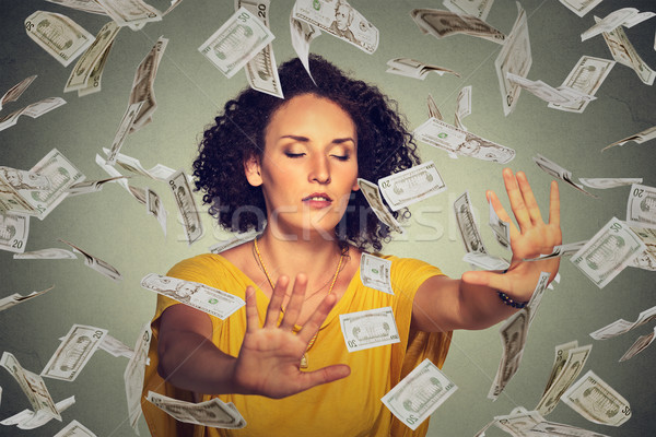 Blindfolded woman with closed eyes trying to catch dollar banknotes flying in air Stock photo © ichiosea