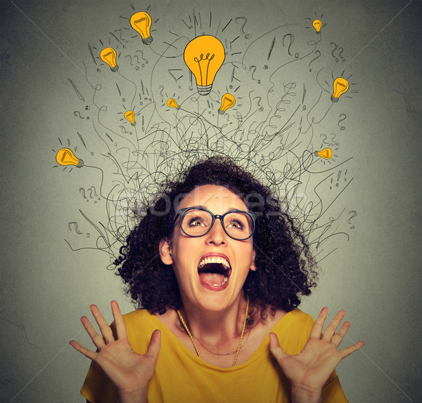 excited happy screaming woman with many light idea bulbs above head  Stock photo © ichiosea