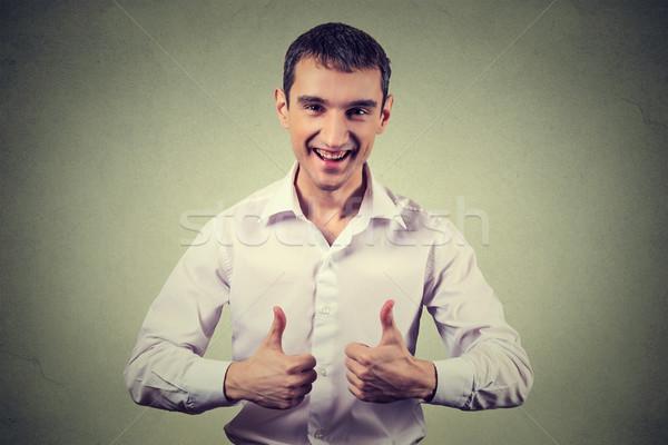 Feliz hombre signo positivo humanos Foto stock © ichiosea