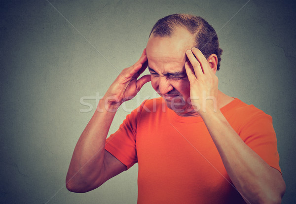Closeup sad middle aged man with worried stressed face expression looking down  Stock photo © ichiosea