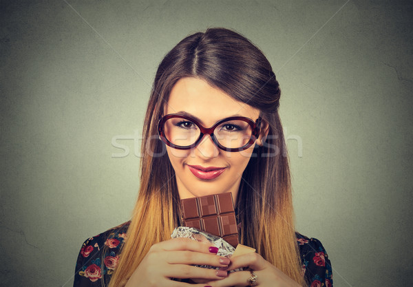 slim woman in glasses tired of diet restrictions craving sweets dark chocolate Stock photo © ichiosea