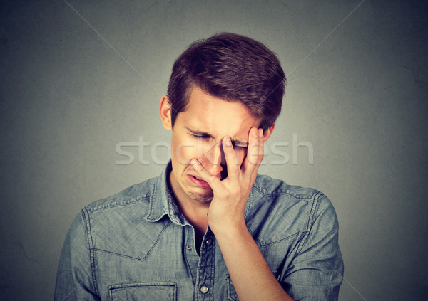 portrait stressed sad young man looking down  Stock photo © ichiosea