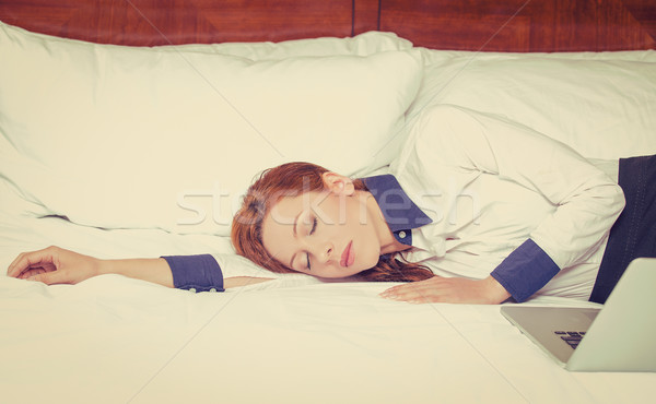 Businesswoman asleep on the bed, hotel or domestic room Stock photo © ichiosea