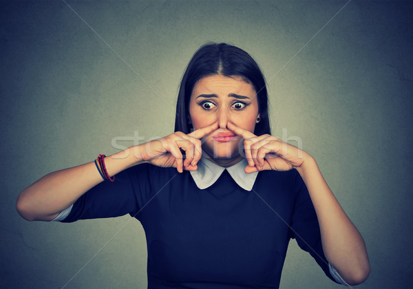 woman pinches nose looks with disgust something stinks bad smell  Stock photo © ichiosea