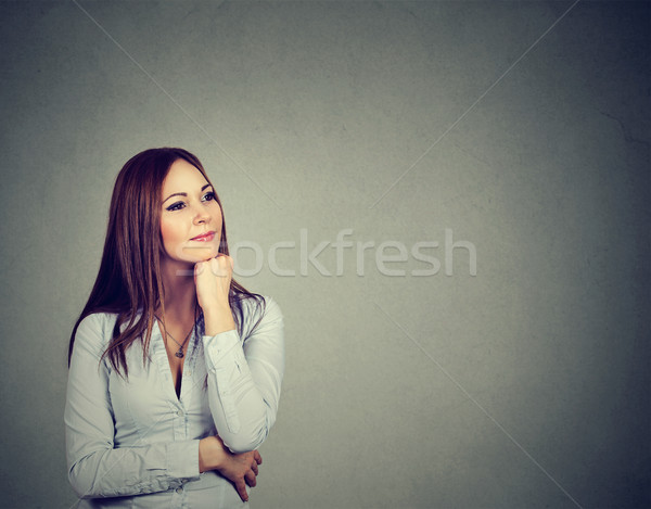 happy woman thinking with hand on chin looking up  Stock photo © ichiosea