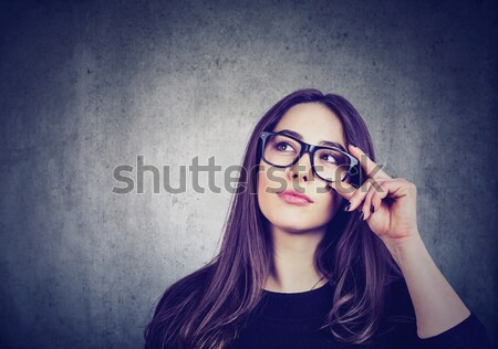 Displeased pessimistic woman with bad attitude looking at you  Stock photo © ichiosea