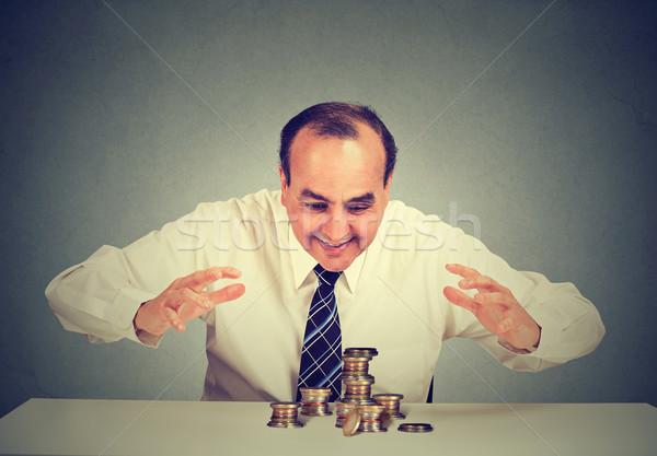 Homem de negócios sessão tabela olhando dinheiro mãos Foto stock © ichiosea