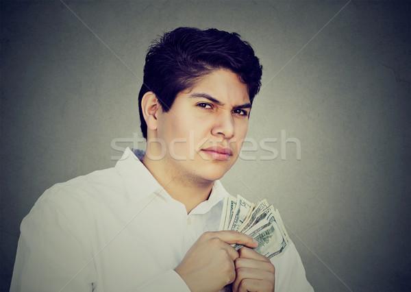 Hebzuchtig verdacht man geld Stockfoto © ichiosea