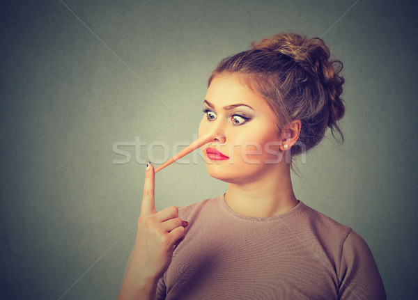 Woman liar with long nose  Stock photo © ichiosea