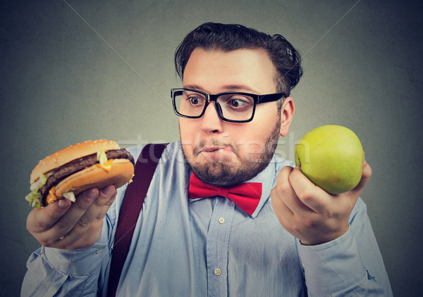 Man suffering from diet restriction Stock photo © ichiosea