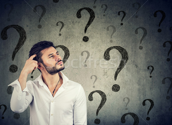 Thoughtful confused man has too many questions and no answer Stock photo © ichiosea