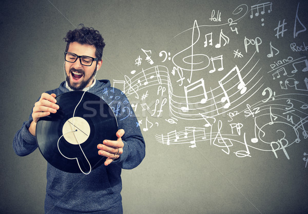 happy man with vinyl record disc listening to music Stock photo © ichiosea