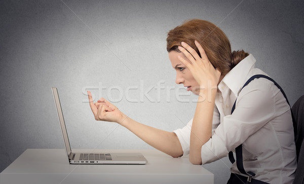 Woman angry annoyed at computer Stock photo © ichiosea