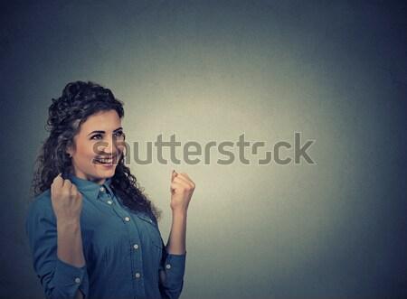 happy woman exults pumping fists celebrates success. Positive human emotions   Stock photo © ichiosea
