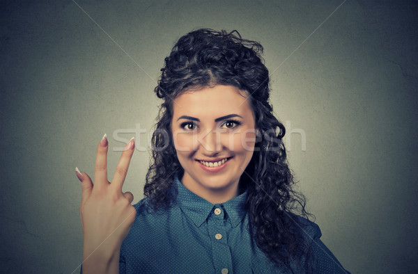 portrait of young pretty woman giving a three fingers sign gesture Stock photo © ichiosea