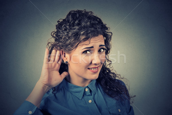 unhappy hard of hearing woman placing hand on ear asking someone to speak up Stock photo © ichiosea