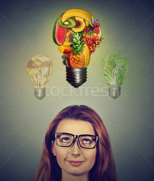 Dieting woman. Girl in glasses thinking looking up at food light bulbs  Stock photo © ichiosea