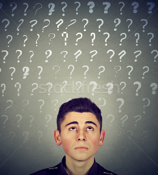 Thoughtful confused man has many questions no answer Stock photo © ichiosea