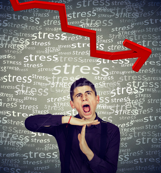 Man showing time out gesture screaming bring down stress level  Stock photo © ichiosea