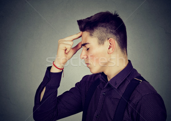 sad depressed man resting head on hand worried  Stock photo © ichiosea