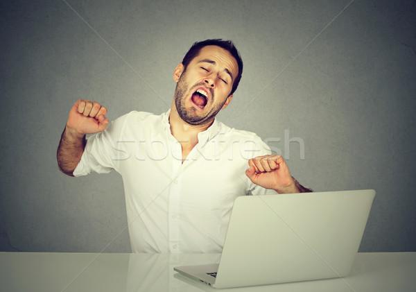 Sleepy worker with laptop computer yawning  Stock photo © ichiosea