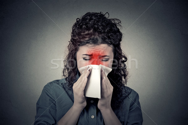 Closeup portrait woman sneezing in a tissue blowing her runny no Stock photo © ichiosea
