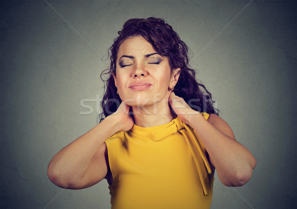 Young woman with neck pain  Stock photo © ichiosea