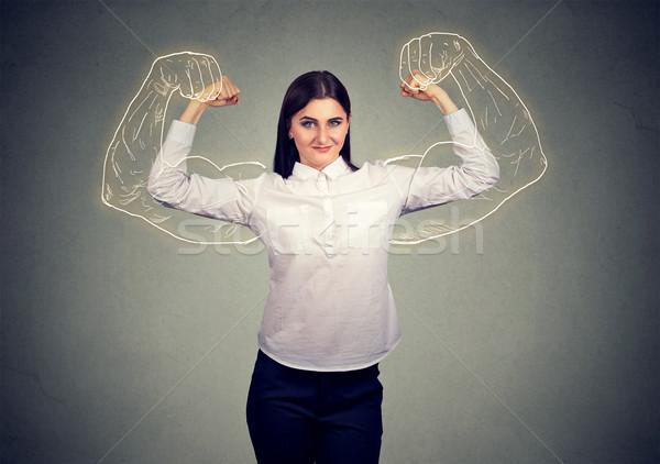 Potente nina músculos negocios mujer manos Foto stock © ichiosea