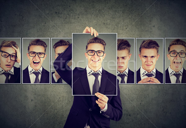 Positive masked young man in glasses expressing different emotions  Stock photo © ichiosea