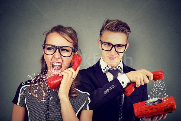 Zangado casal desagradável telefone conversa mulher Foto stock © ichiosea