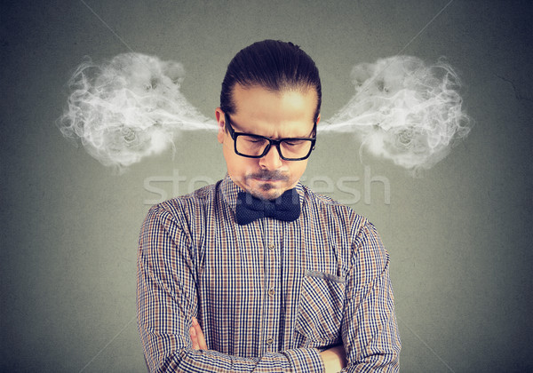 Frustrated man driven mad Stock photo © ichiosea