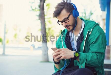 Człowiek czasu parku słuchawki Zdjęcia stock © ichiosea