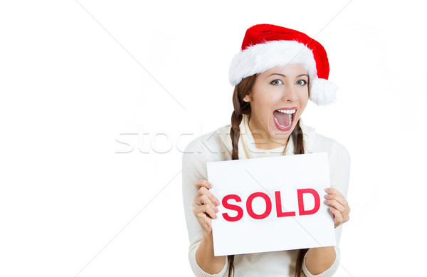 Happy christmas woman holding sold sign Stock photo © ichiosea