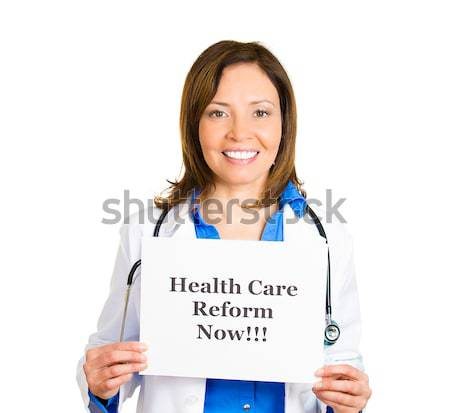 Doctor holding heart and blood pressure sign Stock photo © ichiosea