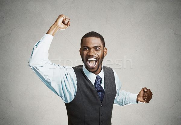 Eccitato felice uomo successo bene risultato Foto d'archivio © ichiosea