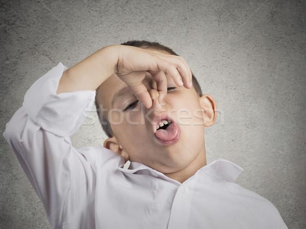 Jongen walging gezicht neus iets Stockfoto © ichiosea
