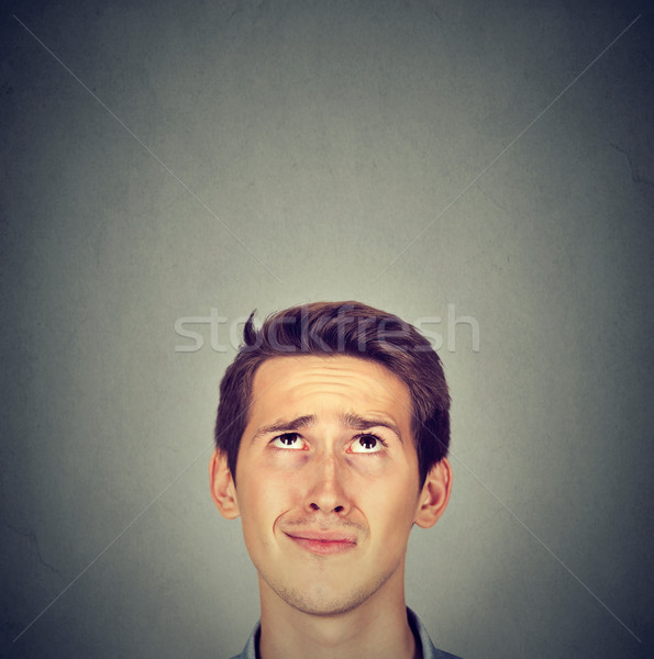 funny confused skeptical man thinking looking up Stock photo © ichiosea