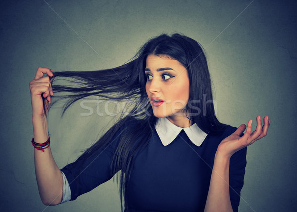 frustrated woman surprised she is losing hair, receding hairline Stock photo © ichiosea
