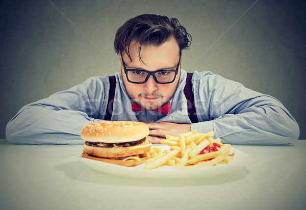 Man anxious about unhealthy fast food Stock photo © ichiosea