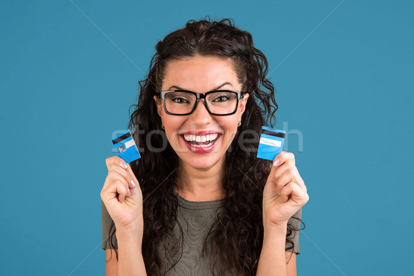 Happy debt free woman holding a credit card cut in two pieces  Stock photo © ichiosea