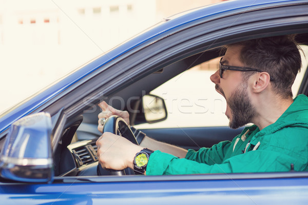 Side profile angry hipster man driver Stock photo © ichiosea
