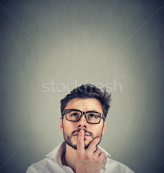 Closeup of a man wondering thinking  Stock photo © ichiosea