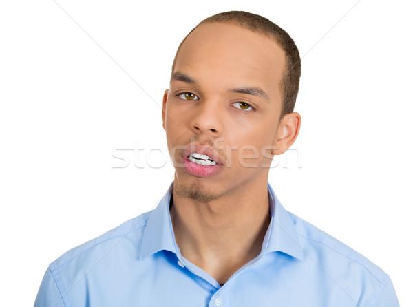 Gyanús közelkép portré szkeptikus fiatalember vicces Stock fotó © ichiosea